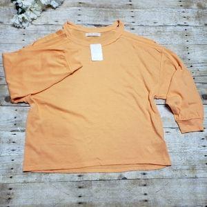 Free people orange shoulderless top